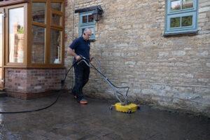pressure washing a block driveway