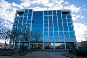 Tall glass modern building in Milton Keynes