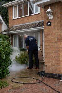 Pressure washing a driveway